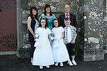 Twins Chloe and Taylor Heavey, who made their First Communion on Saturday at Clogherhead church, pictured with parents Audrey and Michael, sister Shaneece and brother Mikey.