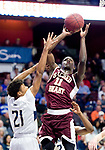 UNCASSVILLE, CT-031818JS13- Sacred Heart's Raheem Solomon (11) puts up a shot over Notre Dame-Fairfield's Rodnet Medor (21) during their Division I championship game Sunday at Mohegan Sun Arena. <br /> Jim Shannon Republican-American