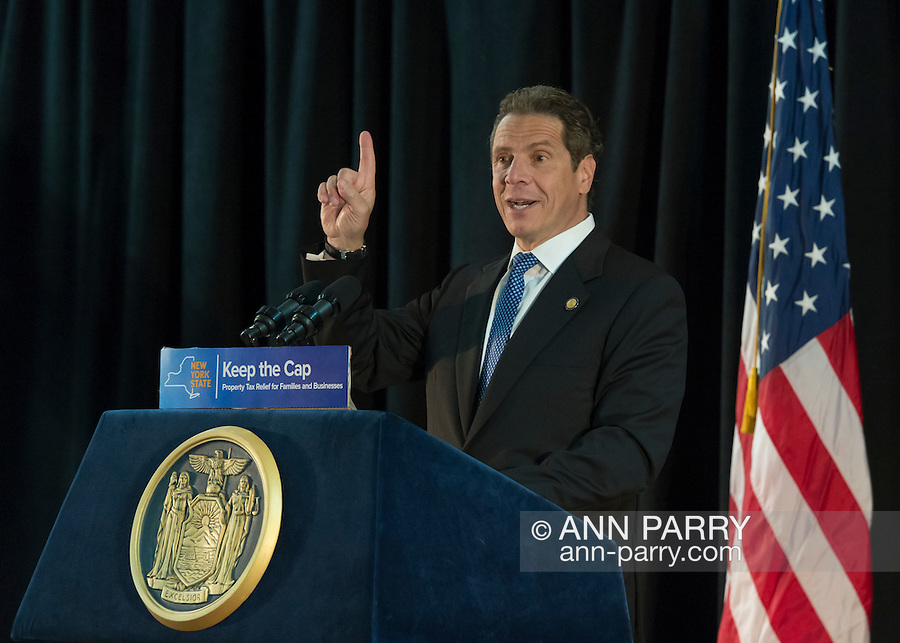 New York State Governor ANDREW CUOMO speaks at Press Conference in support of extending the NY Property Tax Cap. At the bi-partisan event at Knights of Columbus Hall, over a hundred area residents and officials urged an extension of the property tax cap before the state legislative session ends on June 17. The NY Property Tax Cap is set to expire June 2016, but is legally linked to NYC rent-control regulations set to expire this month. In June 2011 in Nassau County, the governor signed the first property tax cap law.