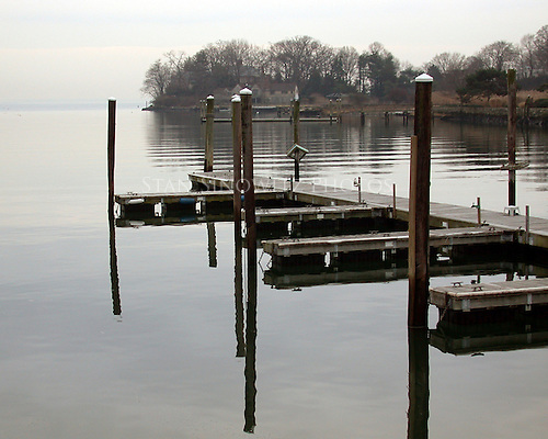 In the winter the docks are empty of boats.  The water is calm and cold on this particular day.
