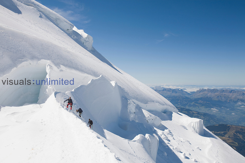 Climbers at the 4000 meter peak of Mont Blanc Du Tacul above Chamonix, France.