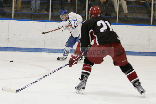 A UK player shoots the puck at UK's home game against Indiana University at Lexington Ice Center in Lexington, Ky., on Friday, Nov. 4, 2011. UK lost 5-3. Photo by Tessa Lighty | Staff