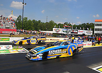 May 17, 2015; Commerce, GA, USA; NHRA funny car driver Matt Hagan (near lane) races  alongside Ron Capps during the Southern Nationals at Atlanta Dragway. Mandatory Credit: Mark J. Rebilas-USA TODAY Sports