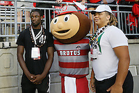 Recruits Josh Sweat, left, and Matt Burrell, right, pose for a photograph with Brutus before the college football game between the Ohio State Buckeyes and the Virginia Tech Hokies at Ohio Stadium in Columbus, Saturday afternoon, September 6, 2014. The Virginia Tech Hokies defeated the Ohio State Buckeyes 35 - 21. (The Columbus Dispatch / Eamon Queeney)