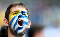 A Uruguay supporter cheers his side on