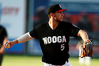 Chattanooga Lookouts third baseman Chris Paul (5) throws to first base for an out during a game against the Mississippi Braves on August 04, 2018 at AT&T Field in Chattanooga, Tennessee. (Andy Mitchell/Four Seam Images)