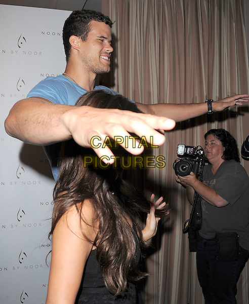 Kim Kardashian & Kris Humphries .The Noon by Noor launch event at At the Sunset Tower in West Hollywood, California, USA..July 20th, 2011         .half length blue t-shirt black strapless dress skirt top circles fiance fiancee engaged couple tall short tall short hands arms profile eyes closed funny.CAP/RKE/DVS.©DVS/RockinExposures/Capital Pictures.