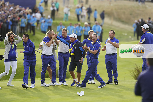 Thorbjorn Olesen (Team Europe)Tyrrell Hatton (Team Europe) Francesco Molinari (Team Europe) and the rest of the European Team jumps on Alex Noran (Team Europe) celebrating his win on the 18th during the singles matches at the Ryder Cup, Le Golf National, Ile-de-France, France. 30/09/2018.<br /> Picture Fran Caffrey / Golffile.ie<br /> <br /> All photo usage must carry mandatory copyright credit (© Golffile | Fran Caffrey)