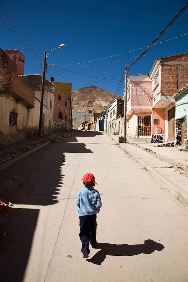 A young boy running up a side street of the Calvario, or miners barrio, of Potosí.