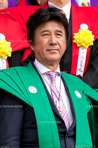 Japanese actor Masao Kusakari attends a Setsubun festival at Naritasan Shinshoji Temple on February 3, 2016, in Chiba, Japan. Setsubun is an annual Japanese festival celebrated on February 3rd and marks the day before the beginning of Spring. Celebrations involve throwing soybeans (known as mamemaki) out of the house to protect against evil spirits and into the house to invite good fortune. In many Japanese families one member will wear an ogre mask whilst others throw beans at him or her. The celebration at Naritasan Shinshoji Temple is one of the biggest in Japan and organizers this year expect over 50,000 people to attend the event. Each year famous sumo wrestlers and actors are also invited to participate in throwing the beans. (Photo by Rodrigo Reyes Marin/AFLO)