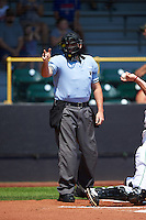 Umpire Matt Snodgrass makes a call during a game between the Great Lakes Loons and Clinton LumberKings on August 16, 2015 at Ashford University Field in Clinton, Iowa.  Great Lakes defeated Clinton 3-2 in ten innings.  (Mike Janes/Four Seam Images)