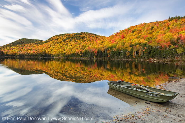 Reflection of autumn foliage in Upper Hall Pond in Sandwich, New Hampshire USA during the autumn months.
