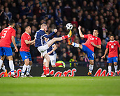 23rd March 2018, Hampden Park, Glasgow, Scotland; International Football Friendly, Scotland versus Costa Rica; Oli McBurnie of Scotland and Johnny Acosta of Costa Rica compete for a high ball