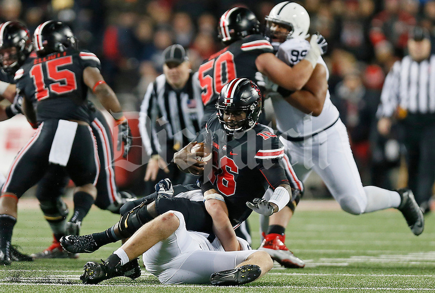 Ohio State Buckeyes quarterback J.T. Barrett (16) gets sacked by Penn State Nittany Lions defensive end Carl Nassib (95) in the third quarter of the college football game between the Ohio State Buckeyes and the Penn State Nittany Lions at Ohio Stadium in Columbus, Saturday evening, October 17, 2015. The Ohio State Buckeyes defeated the Penn State Nittany Lions 38 - 10. (The Columbus Dispatch / Eamon Queeney)
