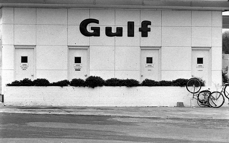 Segregated bathrooms of a Gulf station outside Montgomery, Ala. Photo taken for The Southern Courier sometime in 1966 by Jim Peppler. Copyright Jim Peppler/1966.Photo by Jim Peppler originally published in The Southern Courier Newspaper (now defunct).  This and over 10,000 other images are part of the Jim Peppler Collection at The Alabama Department of Archives and History:  http://digital.archives.alabama.gov/cdm4/peppler.php
