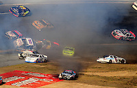 Feb 7, 2009; Daytona Beach, FL, USA; ARCA RE/MAX Series driver Ryan Fischer (15) nearly flips over during a multi car accident in the Lucas Oil Slick Mist 200 at Daytona International Speedway. Mandatory Credit: Mark J. Rebilas-