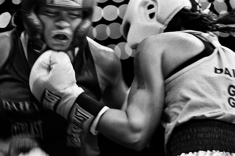 Dominga Regla (left), 29, from Sunset Park PAL, is being punched by Melissa Hernandez (right), 25, from Morris Park BC, during the 2005 Daily News Golden Gloves 132-pound women's final at the Theatre of Madison Square Garden on April 7th,