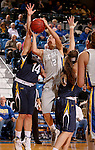 BROOKINGS, SD - OCTOBER 30:  Macy Miller #12 from South Dakota State University takes the ball to the basket past Jordan Needens #14 from South Dakota School of Mines in the second half of their exhibition game Thursday night at Frost Arena in Brookings. (Photo by Dave Eggen/Inertia)
