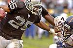 Oakland Raiders running back Charlie Garner (25) stiff-arms Denver Broncos defensive back Nick Ferguson (25) on Sunday, November 30, 2003, in Oakland, California. The Broncos defeated the Raiders 22-8.