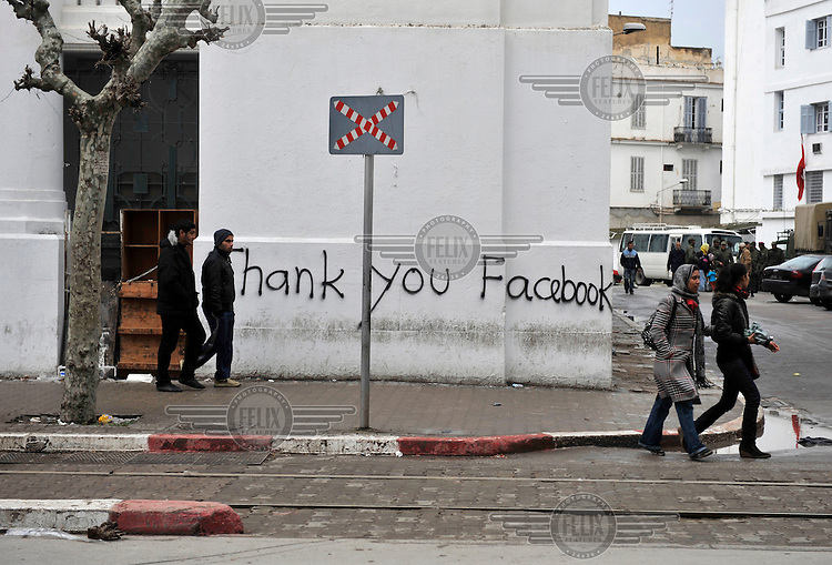 A mural in Tunis thanks the social network site Facebook for its help in realising a more democratic course in Tunisia. Nevertheless, new protests against former prime minister Mohamed Ghannouchi, who took control after the ousting of president Zine El Abidine Ben Ali, turned violent and left at least one dead and several wounded as soldiers used live ammunition and teargas against the protesters..