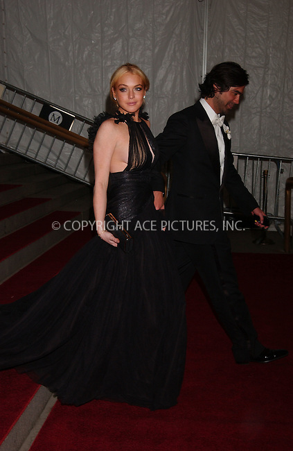 WWW.ACEPIXS.COM . . . . .....May 7, 2007. New York City.....Actress Lindsay Lohan and show designer Brian Atwood leave the 'Poiret: King of Fashion' Costume Institute Gala at The Metropolitan Museum of Art. ..  ....Please byline: Kristin Callahan - ACEPIXS.COM..... *** ***..Ace Pictures, Inc:  ..Philip Vaughan (646) 769 0430..e-mail: info@acepixs.com..web: http://www.acepixs.com
