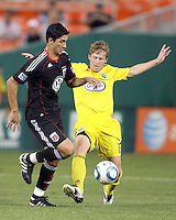 Pablo Hernandez #21 of D.C. United is tackled by Brian Carroll #16 of the Columbus Crew during an MLS match at RFK Stadium on September 4 2010, in Washington DC. Columbus won 1-0.