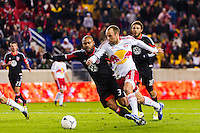 Joel Lindpere (20) of the New York Red Bulls and Robbie Russell (3) of D. C. United. D. C. United defeated the New York Red Bulls 1-0 (2-1 in aggregate) during the second leg of the MLS Eastern Conference Semifinals at Red Bull Arena in Harrison, NJ, on November 8, 2012.