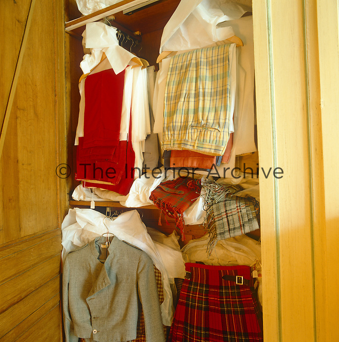 The wardrobe in the Duke of Windsor's dressing room shows his trousers hanging between sheets of white tissue paper