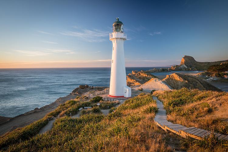 Castlepoint lighthouse at sunrise, looking towards Castle Rock, Coastal Wairarapa, New Zealand - stock photo, canvas, fine art print