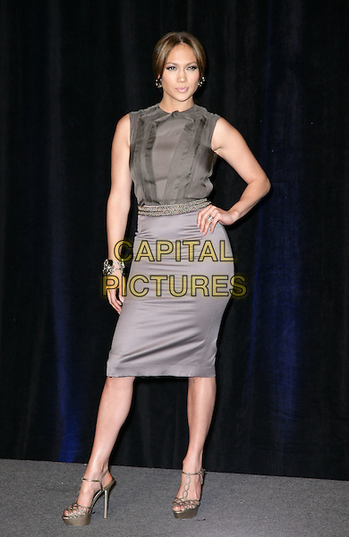 JENNIFER LOPEZ.CBS Films ShoWest Luncheon at the Paris Resort Hotel and Casino,  Las Vegas, Nevada, USA,.18th March 2010..full length grey gray pencil skirt  sleeveless top blouse brown ruffle ruffles gold belt waist waistband platform shoes heels sandals bracelet hand on hip .CAP/ADM/MJT.© MJT/AdMedia/Capital Pictures.