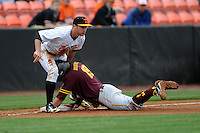 Tennessee Volunteers third baseman Will Maddox #1 applies a tag to the hard sliding Johnny Sewald #18 during a game against  the Arizona State Sun Devils at Lindsey Nelson Stadium on February 23, 2013 in Knoxville, Tennessee. The Volunteers won 11-2.(Tony Farlow/Four Seam Images).