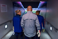 , FL - : Ashlyn Harris #18, Graeme Abel, and Adrianna Franch #21 of the United States walk onto the field during a game between  at  on ,  in , Florida.