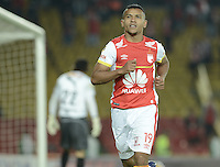 BOGOTÁ -COLOMBIA, 24-03-2015: Wilson Morelo jugador de Independiente Santa Fe celebra su segundo gol anotado a Deportivo Independiente Medellin, durante partido aplazado por la fecha 6 entre Independiente Santa Fe y Deportivo Independiente Medellin de la Liga Aguila I-2015, en el estadio Nemesio Camacho El Campin de la ciudad de Bogota. / Wilson Morelo player of Independiente Santa Fe, celebrates his second goal scored goal to Deportivo Independiente Medellin, during a postponed match of the 6 date between Independiente Santa Fe and Deportivo Independiente Medellin for the Liga Aguila I -2015 at the Nemesio Camacho El Campin Stadium in Bogota city. Photo: VizzorImage/ Gabriel Aponte / Staff