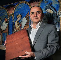 "Ricardo Coll, director, showing the ""Crusader bible"" in his office at the printing studio of Scriptorium SL in Valencia, Spain. Picture by Manuel Cohen"