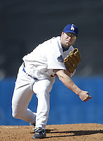 Eric Gange of the Los Angeles Dodgers pitches during a 2002 MLB season game at Dodger Stadium, in Los Angeles, California. (Larry Goren/Four Seam Images)