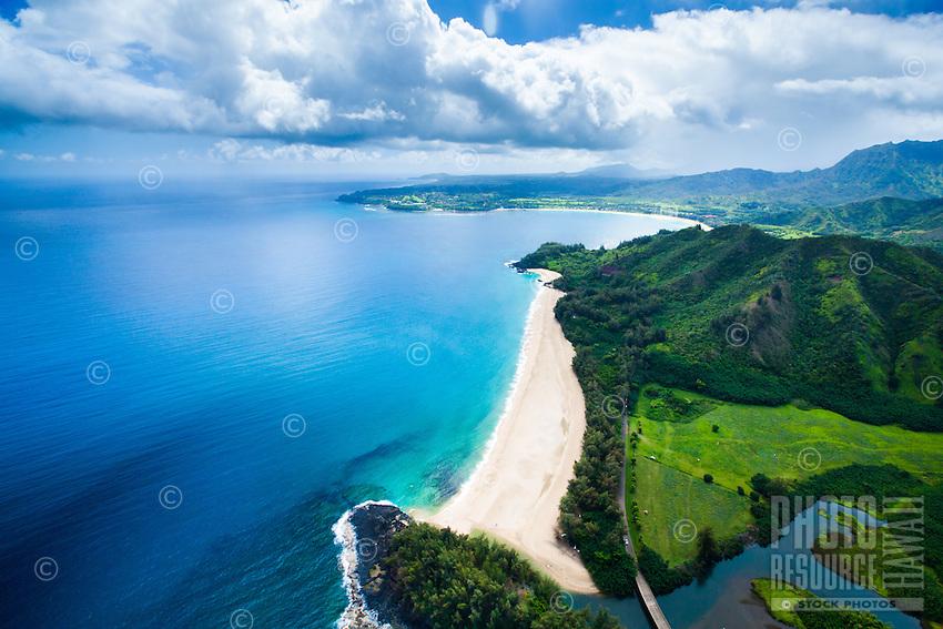 An aerial perspective of Lumahai Beach near the St. Regis Princeville Resort, Hanalei Bay, Kaua'i.