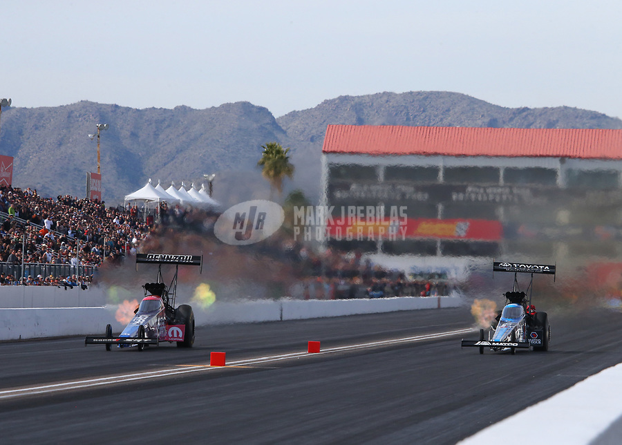 Feb 24, 2019; Chandler, AZ, USA; NHRA top fuel driver Leah Pritchett (left) alongside Antron Brown during the Arizona Nationals at Wild Horse Pass Motorsports Park. Mandatory Credit: Mark J. Rebilas-USA TODAY Sports