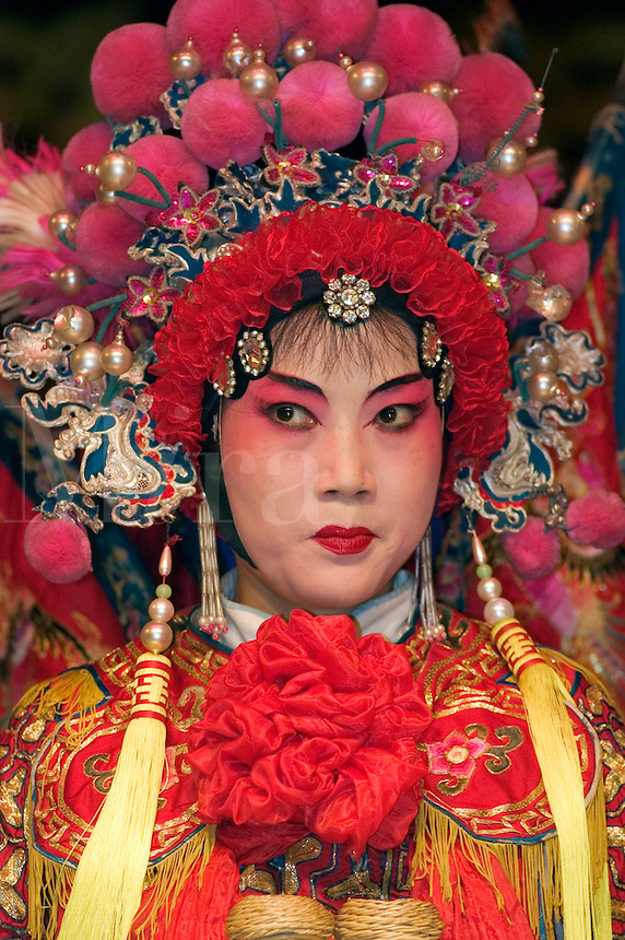 Female star sing in full costume with headdress at the Chinese Opera - Chengdu, China in Sichuan Province