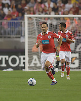 SL Benfica defender César Peixoto (25) accelerates with the ball. SL Benfica  defeated New England Revolution, 4-0, at Gillette Stadium on May 19, 2010.