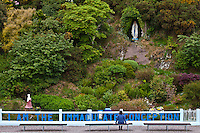 Pilgrim at Grotto of the Virgin Mary and The Immaculate Conception at Ballinspittle near Kinsale, County Cork, Ireland