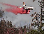 DC 10 air tanker 911 drops retardant on ridge above the Merced River at the South Fork Fire near Wawona  on August 14, 2017 in Yosemite National Park.  Photo by Al Golub/Golub Photography