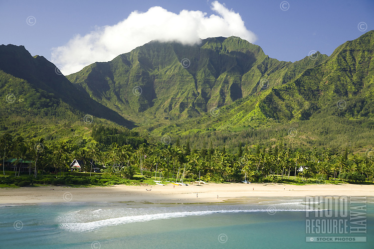 High angle view of Hanalei Beach and clear blue water with Namolokama Mountain in the background