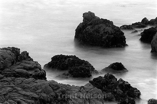Slow-shutter waves and rocks at Pebble Beach.<br />