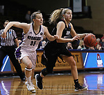 SIOUX FALLS, SD: MARCH 19: Lauren Wolosik #24 of Indiana (PA) drives past Stonehill defender Grace Carter #35 during their game at the 2018 Division II Women's Elite 8 Basketball Championship at the Sanford Pentagon in Sioux Falls, S.D. (Photo by Dick Carlson/Inertia)
