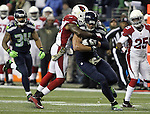 Arizona Cardinals safety Deone Bucannon (20) wraps up Seattle Seahawks tight end Jimmy Graham (88) at CenturyLink Field in Seattle, Washington on November 15, 2015. The Cardinals beat the Seahawks 39-32.   ©2015. Jim Bryant photo. All Rights Reserved.