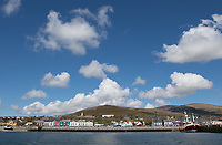 The colorful town of Dingle, photographed from a boat.