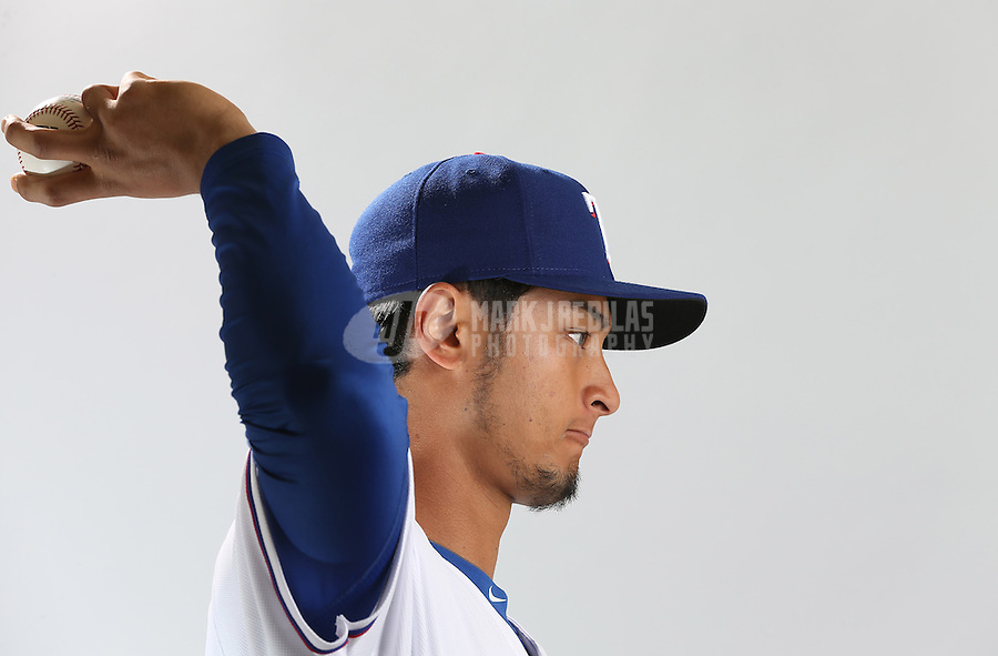 Feb. 20, 2013; Surprise, AZ, USA: Texas Rangers pitcher Yu Darvish poses for a portrait during photo day at Surprise Stadium. Mandatory Credit: Mark J. Rebilas-
