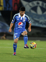 BOGOTA- COLOMBIA -04 -02-2014: Omar Vasquez jugador de Millonarios durante partido de la cuarta fecha de la Liga Postobon I 2014, jugado en el Nemesio Camacho El Campin de la ciudad de Bogota. / Omar Vasquez player of Millonarios a goal scored during a match for the fourth date of the Liga Postobon I 2014 at the Nemesio Camacho El Campin Stadium in Bogoto city. Photo: VizzorImage  / Luis Ramirez / Staff