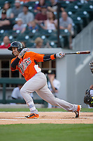 Dariel Alvarez (10) of the Norfolk Tides follows through on his swing against the Charlotte Knights at BB&T BallPark on April 9, 2015 in Charlotte, North Carolina.  The Knights defeated the Tides 6-3.   (Brian Westerholt/Four Seam Images)