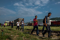 ARRIAGA, MEXICO - NOVEMBER 08: The group of migrants walk along the track at the start of their walk from Arriaga on the El Camino north towards the US on the 8th of November, 2015 in Arriaga, Mexico. <br /> <br /> Daniel Berehulak for The New York Times